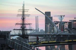 The sales of the Jeanie Johnston rise over Dublin's bridges