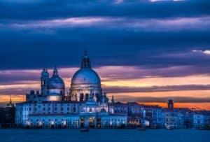 Basilica of Santa Maria della Salute in Venice lit by sunset