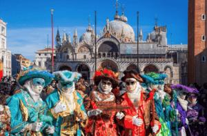 celebrators in full costumed at the Carnavale festival in Venice