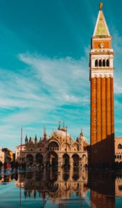 The tower of Piazza San Marco stands against the blue sky in Venice