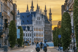 cyclists ride down the center of the street in Leuven belgium