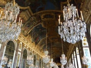 Artwork covers the ceiling in the Hall of Mirrors at the Palace of Versailles