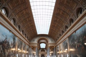 Beautiful artwork lines the halls of the Palace of Versailles in France