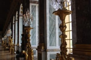 Beautiful statues and lighting line the Hall of Mirrors