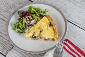 A delicious French quiche with salad