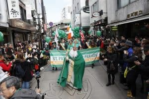 A man dressed as St. Patrick leads the parade in Japan