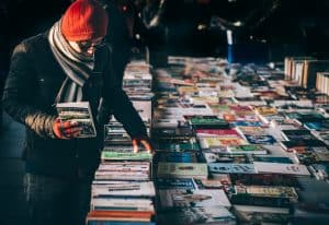 A man shopping for books at a flea market