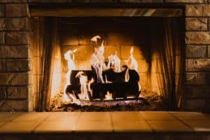 A relaxing image of a log fireplace