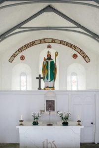 A statue of St. Patrick in a church