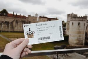 A woman holding her entrance ticket to the Tower of London