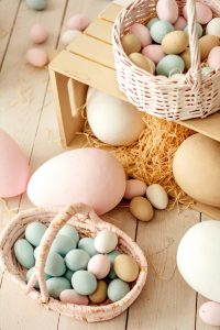 Colourful eggs in woven baskets