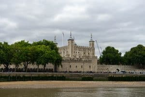 Guests pass in front of the Tower of London