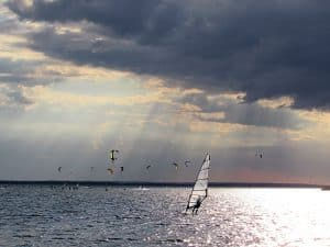 Kite surfers out on the ocean