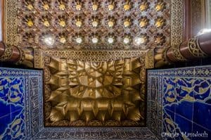 Mihrab cover in the mosque with gilded muqarnas