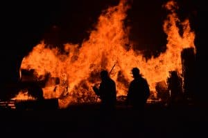 People celebating Guy Fawkes night with bonfires