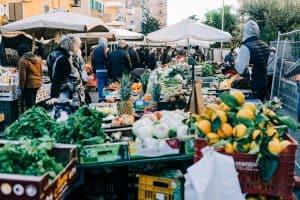People walking through a farmers market