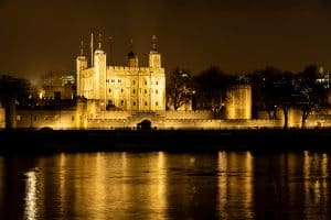 The Tower of London's reflection in the nighttime waters