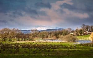 The snow-capped Cuilcagh Mountains seen from Belle Isle Estate in County Fermanagh