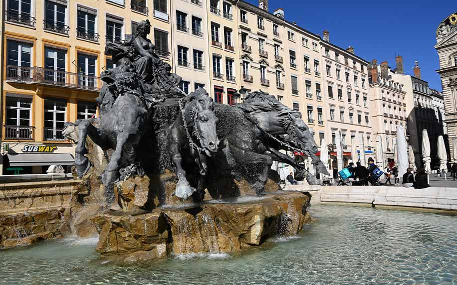 an image of bartholdis fountain in the centre of lyon