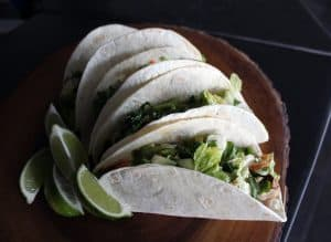 Soft-shelled tacos with lime wedges