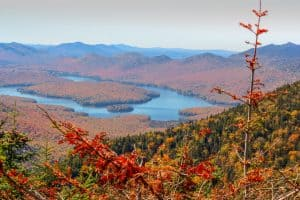 view of lakes in the Adirondack mountains during color changing fall leaves.