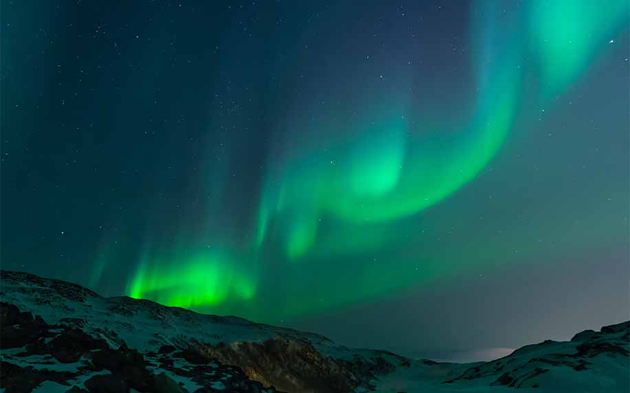 a shot of the beautiful green aurora borealis also known as the nothern lights