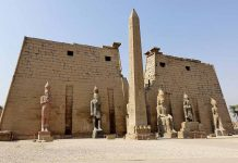 the front facade of the luxor temple, a large Ancient Egyptian temple complex located on the east bank of the Nile River