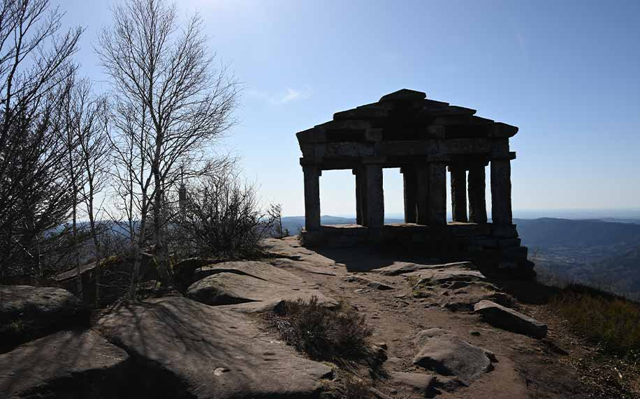 a shot of the temple of mercury at the top of le donon