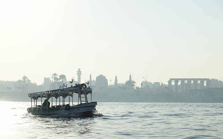 a shot of a boat on the Nile River