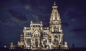 Baron Empain Palace lit up at night in Egypt