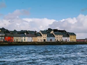 Views of the multi-colored houses along the Corrib River in Galway County