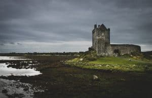 A gloomy photo of Kinvara bay and Dunguaire castle in Galway County