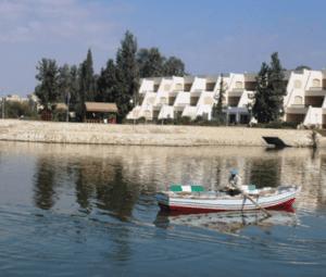 A boat glides along lake Qarun