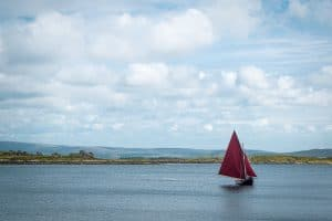 The Galway Hooker boat Sails on the bays of Roundstone in Galway County