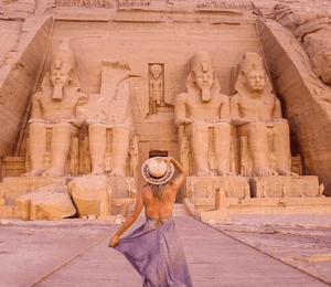 Girl with her back turned away from the camera facing the Temple of abu simbel