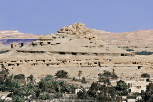 A landscape photo of the mountain of dead in Siwa Oasis
