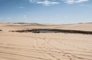 Bir Wahed and the surrounding dunes in Siwa Oasis