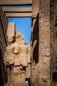 Stone carvings of men at the Temple of Amun located just outside Siwa Oasis