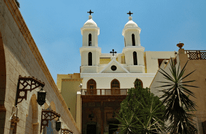 The gorgeous church with twin pillars immersing from it's roof tops stands tall in Egypt