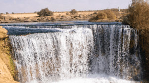 waterfall cascading out of the desert in El Fayum