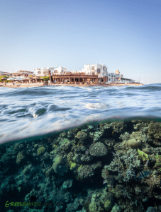 A view of the shore and the coral reef at the Lighthouse Reef in Dahab