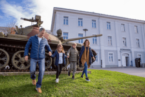 A family enjoys the Military museum in Pivka, Slovenia