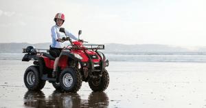a woman sits on a quad bike in Sahl Hashish