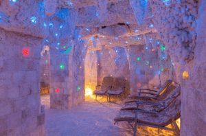 A salt cave lit up with comfy chair in Taba