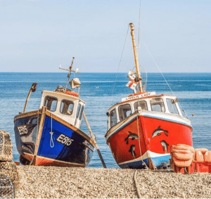 Two fishing boats pulled ashore waiting for use in Sahl Hashish
