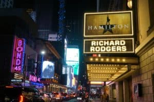 The Hamilton Marquee sign is lit on the streets of New York City