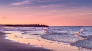 The sun sets over the beach on the island of Cape Cod in New England