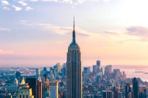 The Empire State Building stands at attention among the other building in New York City