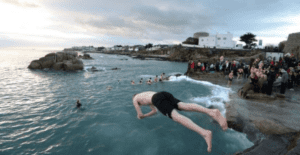 A man jumps off a platform into the sea at the Forty-Foot in Ireland