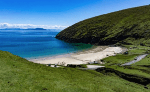 The dark blue waters meet the white sand in Keem Bay, Ireland